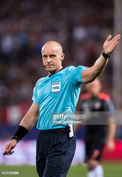 Referee Szymon Marciniak signals during their 201617 UEFA Champions League match between Atletico Madrid vs FC Bayern Munich at the Vicente Calderon...