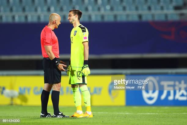 Referee Szymon Marciniak talks with Andrea Zaccagno of Italy during the FIFA U20 World Cup Korea Republic 2017 Round of 16 match between France and...