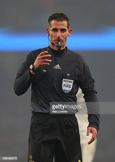 Referee Tasos Sidriopoulos looks on during the UEFA Champions League Group E match between Manchester City and CSKA Moscow on November 5 2014 in...