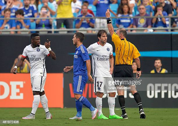 Referee Ted Unkel shows the yellow card to Serge Aurier of Paris SaintGermain during their International Champions Cup match at Bank of America...