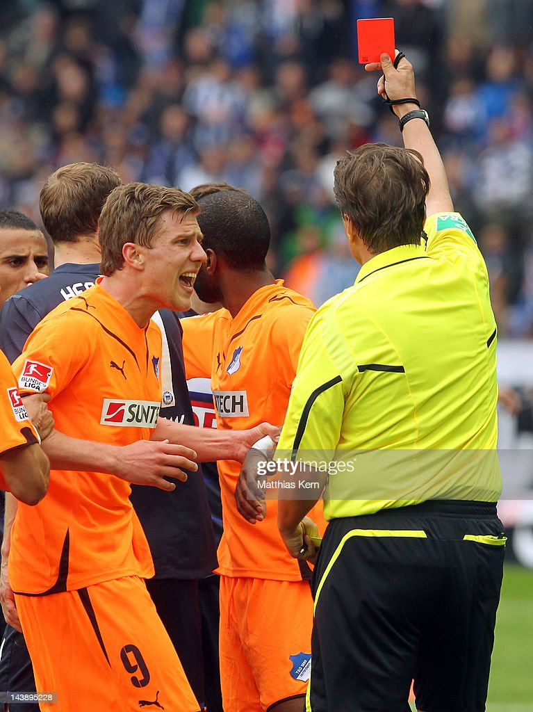 Referee Thorsten Kinhoefer shows the red card to Ryan Babel of Hoffenheim during the Bundesliga match between Hertha BSC Berlin and TSG 1899...