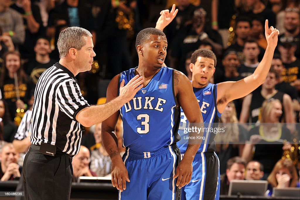 Referee Tim Nestor talks to Tyler Thornton #3 of the Duke Blue Devils during a game against the Wake Forest Demon Deacons at Lawrence Joel Coliseum on January 30, 2013 in Winston-Salem, North Carolina. Duke defeated Wake Forest 75-70.