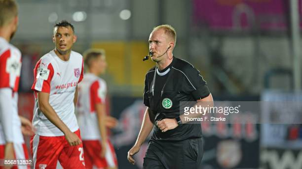 Referee Tobias Fritsch whistles during the 3 Liga match between Sportfreunde Lotte and Hallescher FC at Frimo Stadium on September 29 2017 in Lotte...
