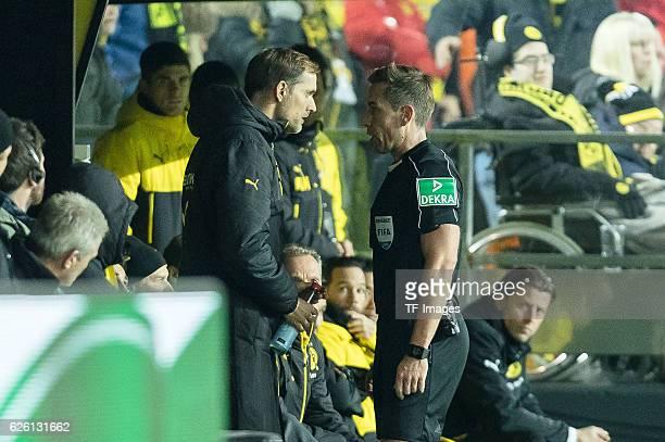 referee Tobias Stieler and coach Thomas Tuchel of Borussia Dortmund looks on during the Bandesliga soccer match between BV Borussia Dortmund and FC...