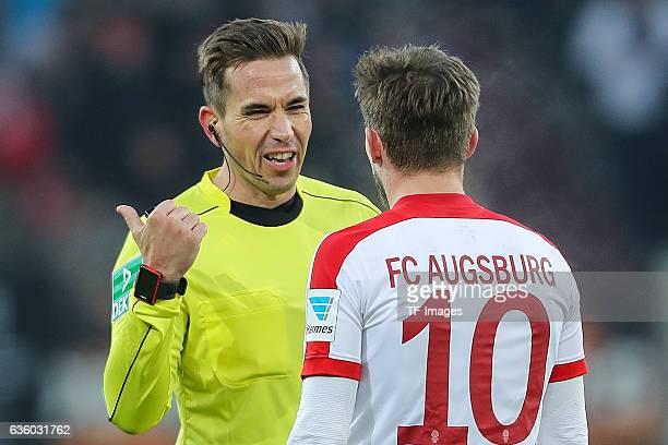 Referee Tobias Stieler Daniel Baier of Augsburg gestures during the Bundesliga match between FC Augsburg and Borussia Moenchengladbach at WWKArena on...