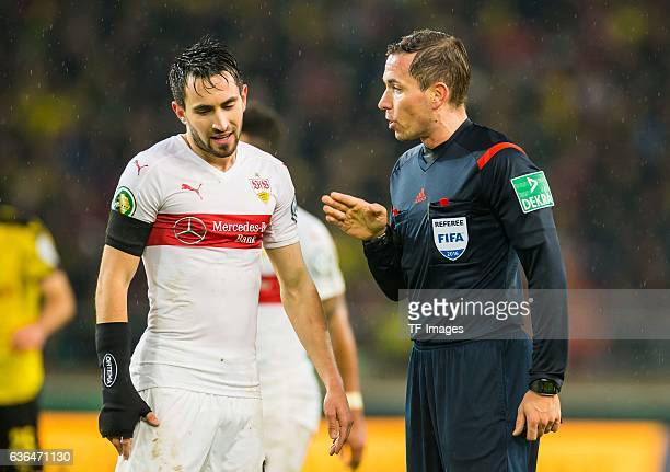 Referee Tobias Stieler discuss with Lukas Rupp of VfB Stuttgart during the DFB Pokal soccer match between VfB Stuttgart and BV Borussia Dortmund at...