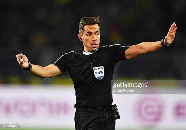 Referee Tobias Stieler gestures during the Bundesliga match between Borussia Dortmund and Bayern Muenchen at Signal Iduna Park on November 19 2016 in...