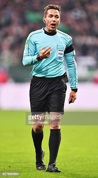 Referee Tobias Stieler gestures during the Bundesliga match between Werder Bremen and FC Ingolstadt 04 at Weserstadion on December 3 2016 in Bremen...