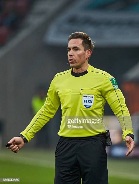 Referee Tobias Stieler gestures during the Bundesliga match between FC Augsburg and Borussia Moenchengladbach at WWKArena on December 17 2016 in...