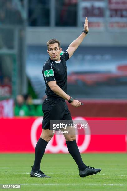 Referee Tobias Stieler gestures during the Bundesliga match between Borussia Moenchengladbach and Bayern Muenchen at BorussiaPark on March 19 2017 in...