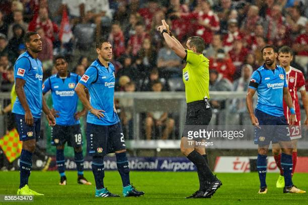 Referee Tobias Stieler gestures during the Bundesliga match between FC Bayern Muenchen and Bayer 04 Leverkusen at Allianz Arena on August 18 2017 in...