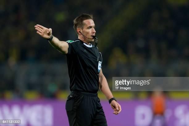 Referee Tobias Stieler gestures during the Bundesliga soccer match between Borussia Dortmund and RB Leipzig at the Signal Iduna Park in Dortmund...