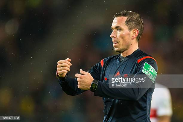 Referee Tobias Stieler gestures during the DFB Pokal soccer match between VfB Stuttgart and BV Borussia Dortmund at MercedesBenz Arena on February 09...