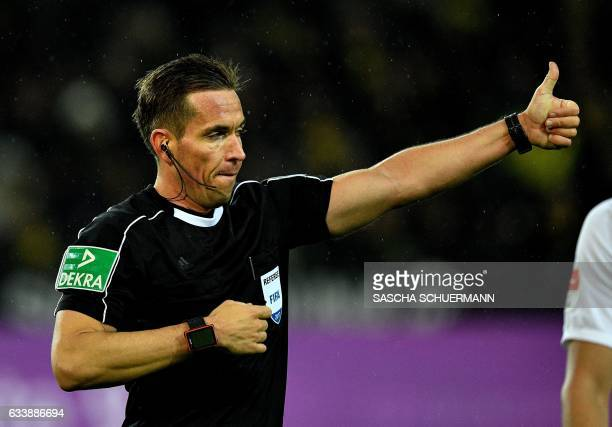 Referee Tobias Stieler gestures during the German First division Bundesliga football match between Borussia Dortmund and RB Leipzig in Dortmund...