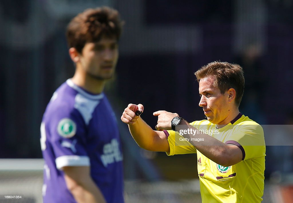 Referee Tobias Stieler gestures during the Third League match between VfL Osnabrueck and Wacker Burghausen at Osnatel Arena on May 4, 2013 in Osnabruck, Germany.