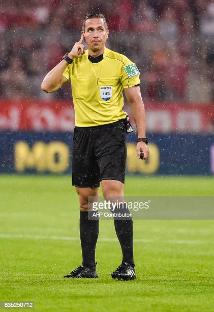 Referee Tobias Stieler listen to the video referee on his ear piece during the German first division Bundesliga football match FC Bayern Munich vs...
