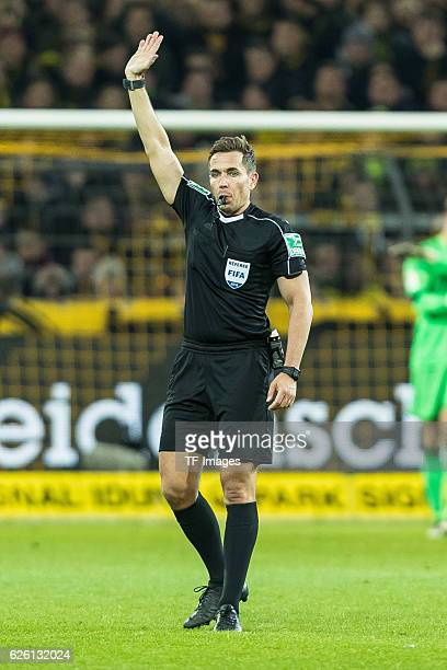 referee Tobias Stieler looks on during the Bandesliga soccer match between BV Borussia Dortmund and FC Bayern Muenchen at the Signal Iduna Park in...