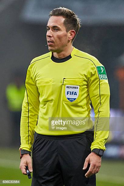 Referee Tobias Stieler looks on during the Bundesliga match between FC Augsburg and Borussia Moenchengladbach at WWKArena on December 17 2016 in...