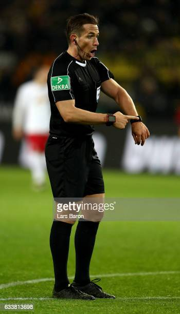 Referee Tobias Stieler makes a point during the Bundesliga match between Borussia Dortmund and RB Leipzig at Signal Iduna Park on February 4 2017 in...