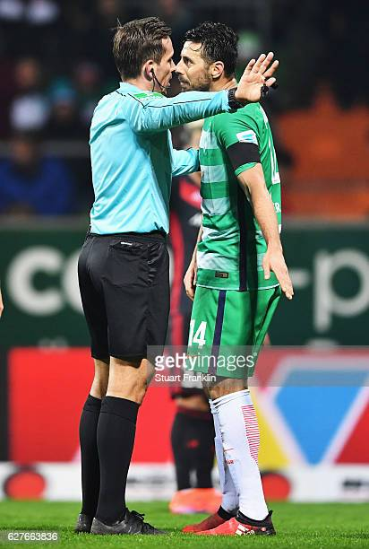 Referee Tobias Stieler makes a point to Claudio Pizarro of Bremen during the Bundesliga match between Werder Bremen and FC Ingolstadt 04 at...