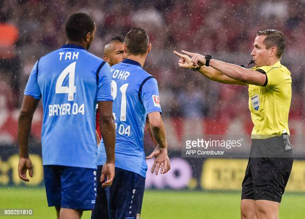 Referee Tobias Stieler makes the tv shape gesture calling for the Video assistant referee VAR to check a scene during the German first division...