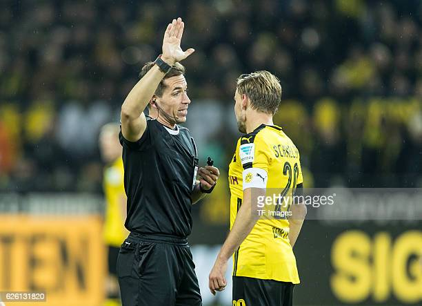 referee Tobias Stieler Marcel Schmelzer of Borussia Dortmund looks on during the Bandesliga soccer match between BV Borussia Dortmund and FC Bayern...