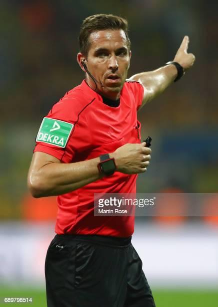 Referee Tobias Stieler reacts during the Bundesliga Playoff leg 2 match between Eintracht Braunschweig and VfL Wolfsburg at Eintracht Stadion on May...