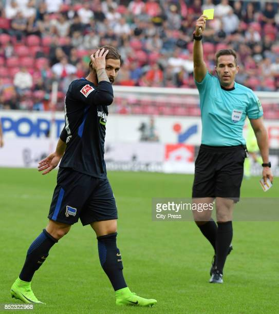 referee Tobias Stieler shows Marvin Plattenhardt of Hertha BSC the yellow card during the game between FSV Mainz 05 and Hertha BSC on september 23...