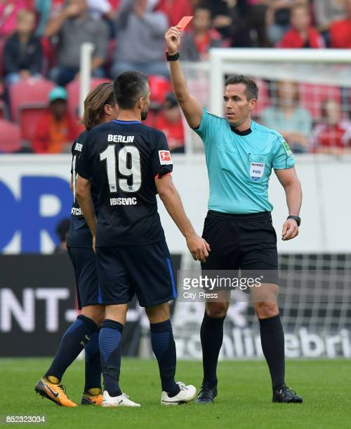 referee Tobias Stieler shows Vedad Ibisevic of Hertha BSC the red card during the game between FSV Mainz 05 and Hertha BSC on september 23 2017 in...