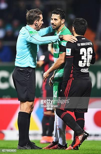 Referee Tobias Stieler talks with Almog Cohen of Ingolstadt and Claudio Pizarro of Bremen during the Bundesliga match between Werder Bremen and FC...