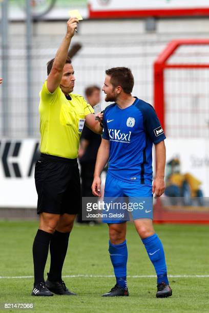 Referee Tobias Stieler with the yellow card for Thilo Leugers of Meppen during the 3 Liga match between SV Meppen and FC Wuerzburger Kickers at...