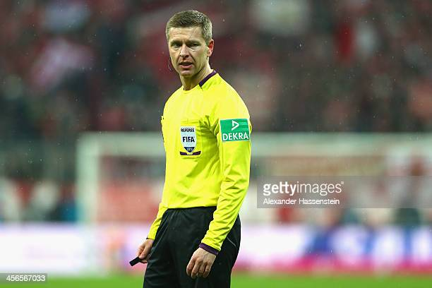 Referee Tobias Welz during the Bundesliga match between FC Bayern Muenchen and Hamburger SV at Allianz Arena on September 28 2013 in Munich Germany