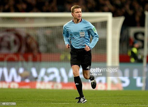 Referee Tobias Welz looks on during the Bundesliga match between 1 FC Nuernberg and VfB Stuttgart at Grundig Stadium on March 26 2014 in Nuremberg...