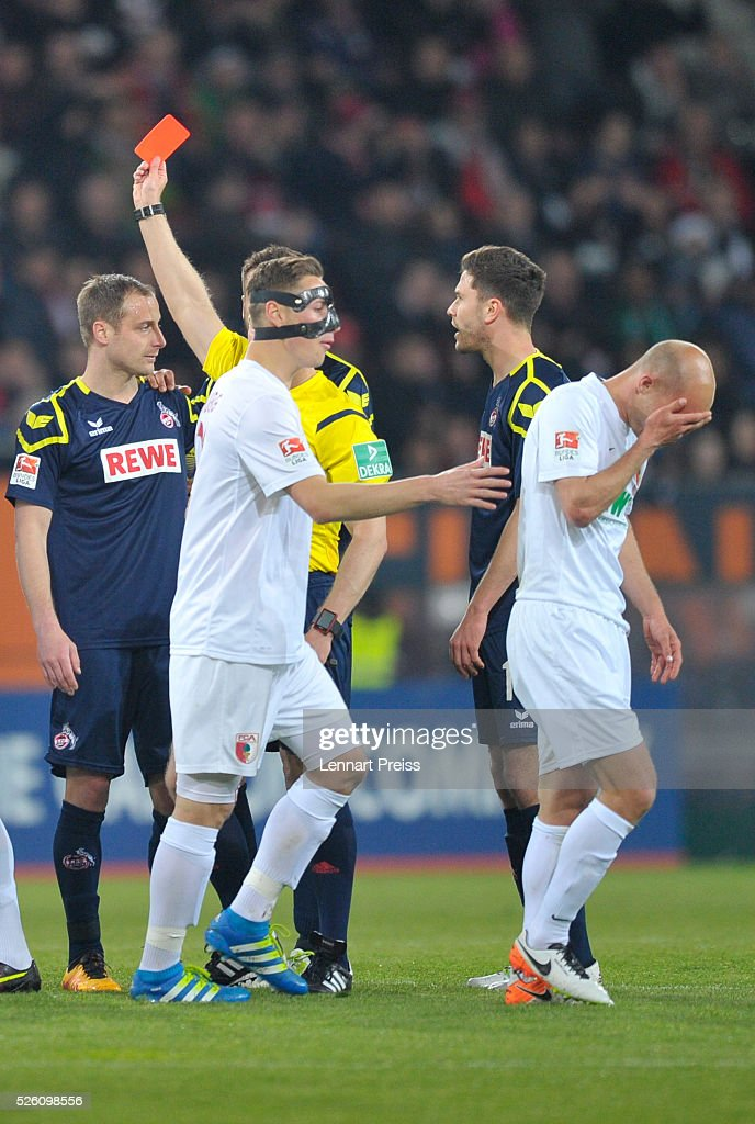 Referee Tobias Welz (2nd L) shows <a gi-track='captionPersonalityLinkClicked' href=/galleries/search?phrase=Matthias+Lehmann&family=editorial&specificpeople=605407 ng-click='$event.stopPropagation()'>Matthias Lehmann</a> (L) of 1. FC Koeln the red card during the Bundesliga match between FC Augsburg and 1. FC Koeln at WWK Arena on April 29, 2016 in Augsburg, Germany.