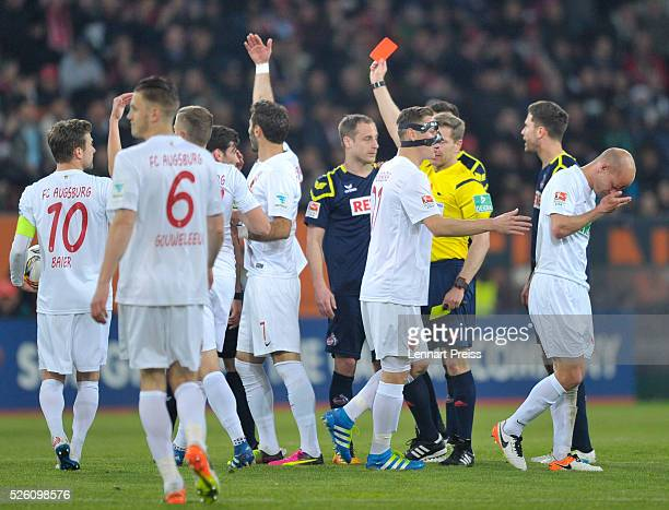 Referee Tobias Welz shows Matthias Lehmann of 1 FC Koeln the red card during the Bundesliga match between FC Augsburg and 1 FC Koeln at WWK Arena on...