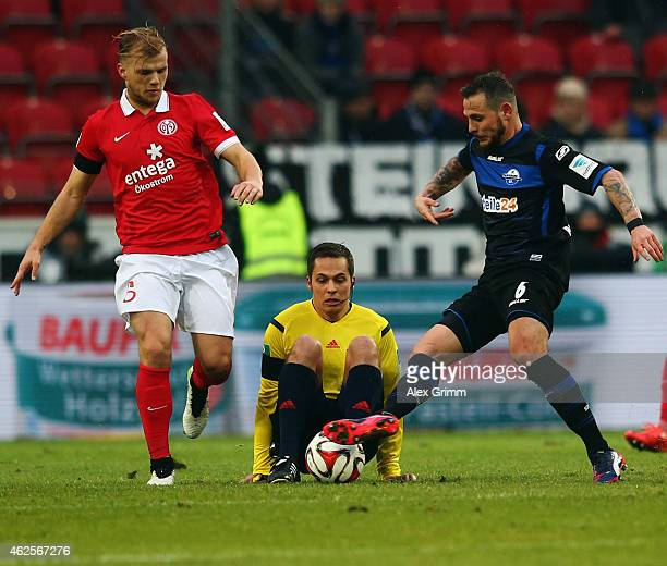 Referee Tobias Welz tumbles as Johannes Geis of Mainz is challenged by Marvin Bakalorz of Paderborn during the Bundesliga match between 1 FSV Mainz...