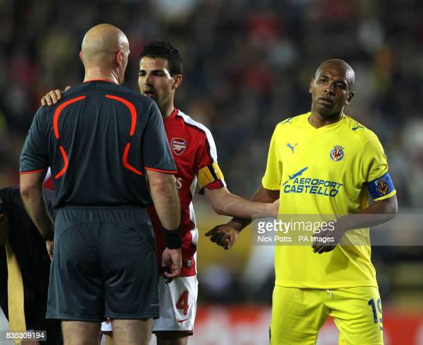 Referee Tom Ovrebo has a word with Arsenal's Francesc Fabregas and Villarreal's Marcos Senna