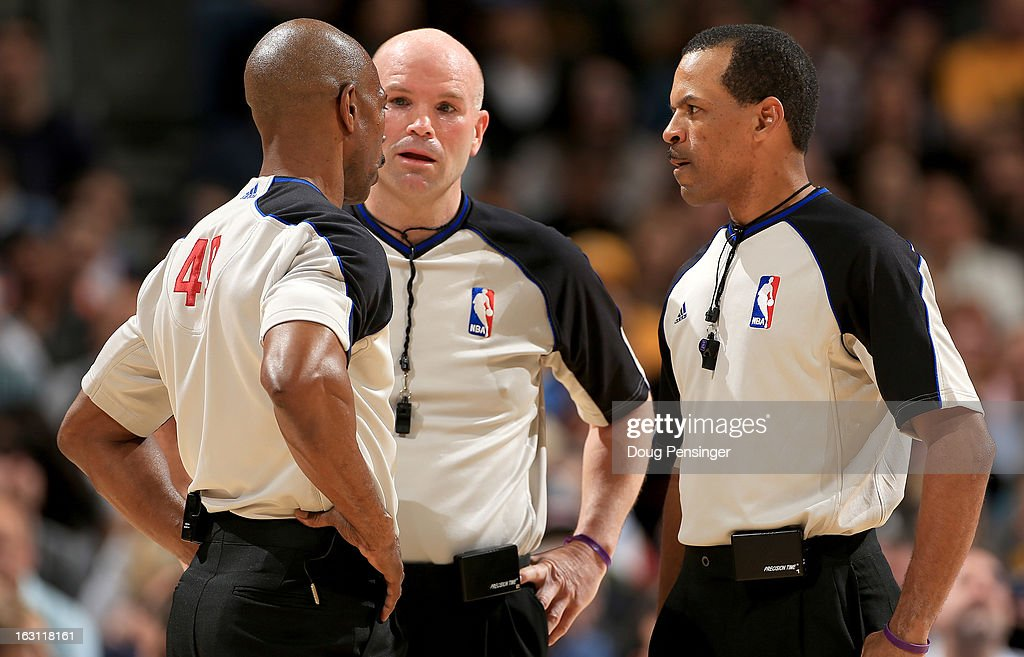 Referee Tom Washington referee Gary Zielinski and referee Eric Lewis talk during a break in the action as the Oklahoma City Thunder face the Denver...