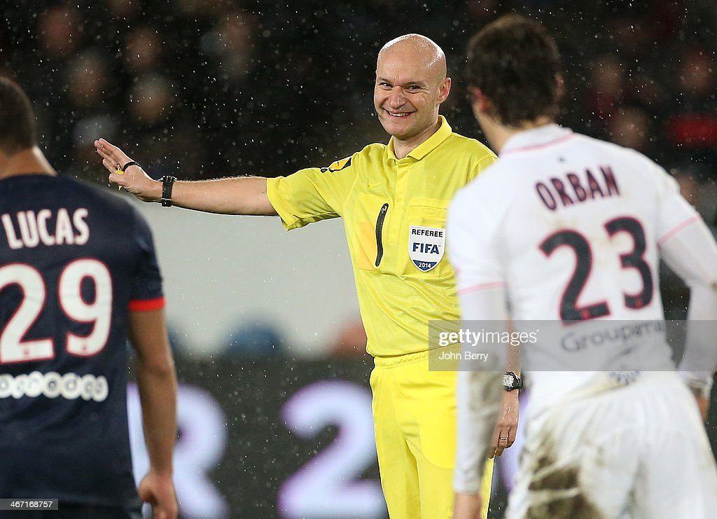 Referee Tony Chapron in action during the Ligue 1 match between Paris Saint-Germain FC and FC Girondins de Bordeaux at the Parc des Princes stadium on January 31, 2014 in Paris, France.
