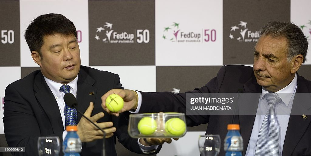 Referee Tony Cho (L) and Sergio Elias of the International Tennis Federation (ITF) are pictured during the draw of the 2013 Fed Cup World Group II first round between Argentina and Sweden to be held this weekend, at Parque Roca stadium in Buenos Aires on February 8, 2012. AFP PHOTO / Juan Mabromata