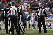 Referee Tony Corrente signals a penalty in the fourth quarter during a game between the St Louis Rams and the Baltimore Ravens at MT Bank Stadium on...