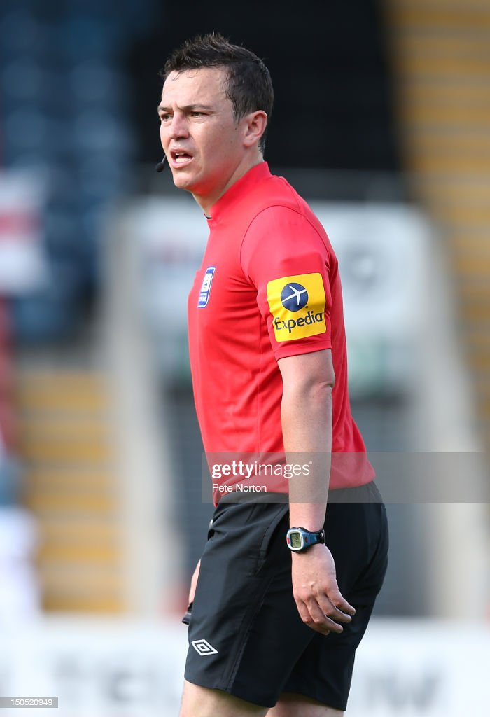 Referee Tony Harrington in action during the npower League Two match between Rochdale and Northampton Town at Spotland Stadium on August 18, 2012 in Rochdale, England.