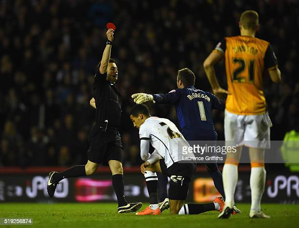 Referee Tony Harrington shows Moses Odubajo of Hull City a red card during the Sky Bet Championship match between Derby County and Hull City on April...
