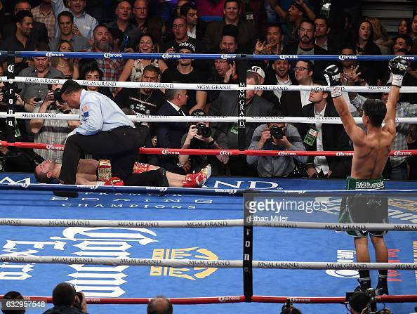 Referee Tony Weeks checks on Dejan Zlaticanin after he was knocked out by Mikey Garcia in the third round of their WBC lightweight title fight at MGM...
