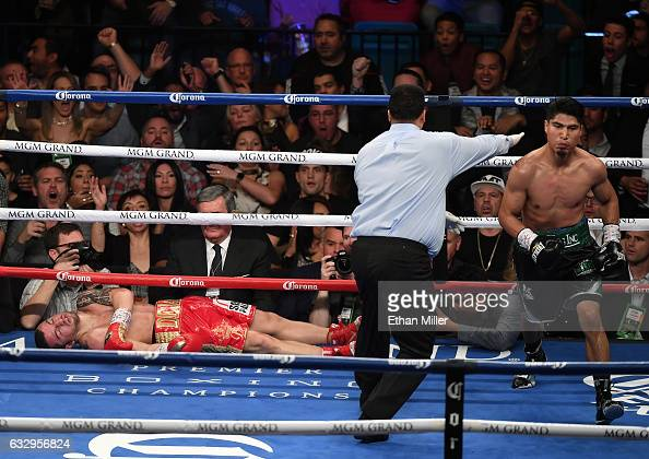 Referee Tony Weeks directs Mikey Garcia to a neutral corner after he knocked out Dejan Zlaticanin in the third round of their WBC lightweight title...