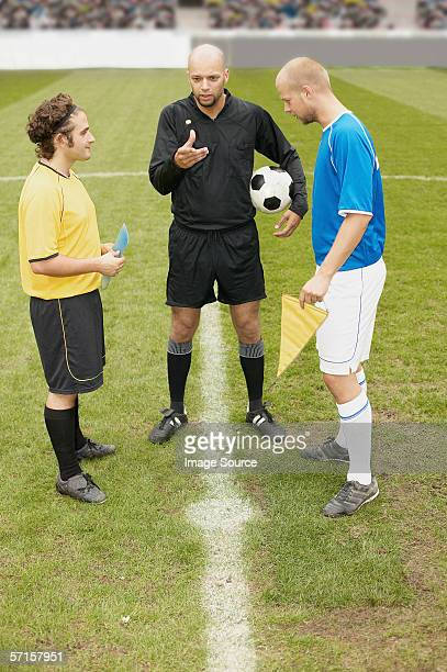 Referee tossing a coin