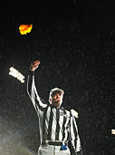 Referee tossing yellow flag