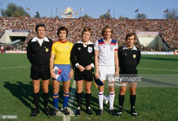 Referee Ulf Eriksson with his linesmen and the team captains Romania's Costica Stefanescu and England's Phil Thompson prior to their World Cup...