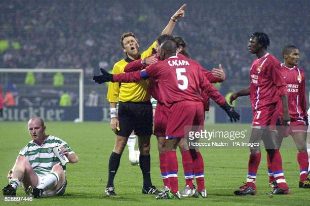 Referee Urs Meier gives a free kick as Olympique Lyonnais protest after a foul against Celtic's John Hartson during their Champions League Group A...