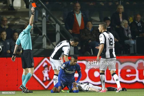 referee van den Kerkhof shows red card to Jeremiah St Juste of Heerenveenduring the Dutch Eredivisie match between Heracles Almelo and sc Heerenveen...